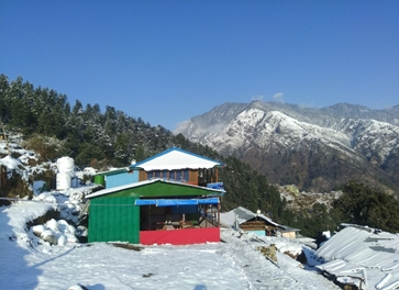 trekkers lodge covered in snow